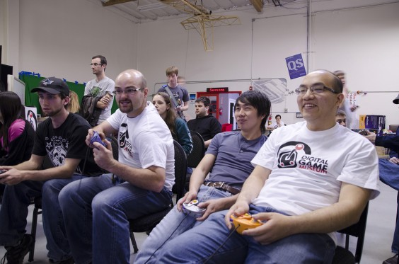 Jeff, far right, keeps his cool while Zak gets carried away at a Mario Tournament